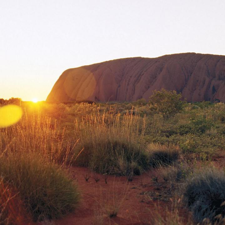 sunrise behind Uluru
