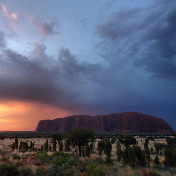 Sun setting behind Ayers Rock