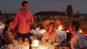 Outdoors, nighttime dining in the Australian outback